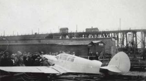 Markham's plane being loaded onto a boat to be taken to Louisbourg. (This image is from nsexplore.ca.)